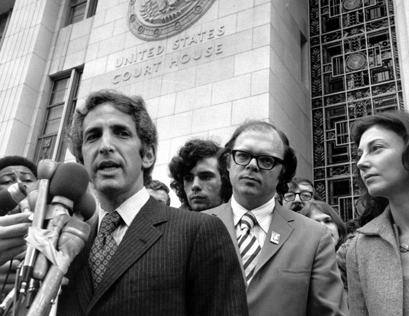 Daniel Ellsberg, who leaked the Pentagon Papers in one of the most dramatic acts of whistle-blowing in U.S. history, speaks to reporters outside the Federal Building in Los Angeles in this photo from Jan. 17, 1973. Ellsberg's co-defendant in the case, Anthony Russo, is seen at right.