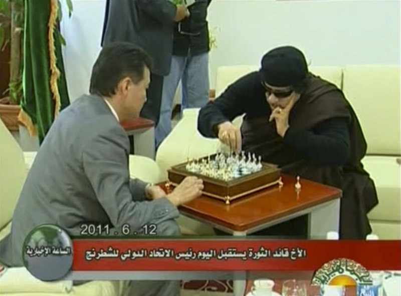Libyan leader Moammar Gadhafi, right, plays chess with Kirsan Ilyumzhinov, the president of the World Chess Federation, on Sunday in Libya. It was unclear why Ilyumzhinov was in the country, but he told reporters that Gadhafi told him he has no plans to leave.