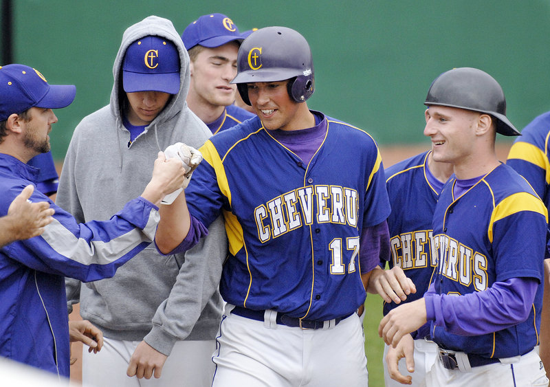 Joey Royer is greeted by his Cheverus teammates after scoring Monday in the Stags' 8-2 win over South Portland in their regional 'A' semifinal.