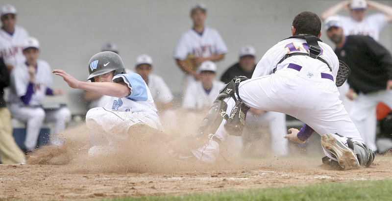 Westbrook's Kaleb Kent slides past Marshwood catcher Matt Brenner to score the winning run Monday in the sixth inning of their Class A regional semifinal in Westbrook. The Blazes move on to the regional final for the third time in four years. They play Cheverus on Wednesday.