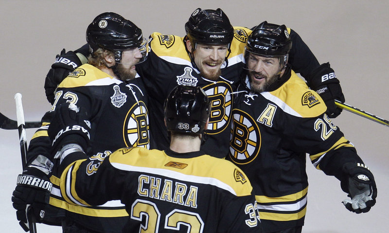 Bruins Zdeno Chara, foreground, Michael Ryder, left, Andrew Ference, center, and Mark Recchi celebrate Ference's goal in Boston's four-goal first period Monday night in Boston.