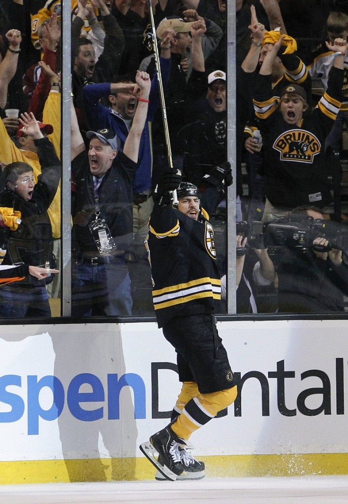 Milan Lucic celebrates his first-period goal. He scored 35 seconds after Brad Marchand for a 2-0 lead.