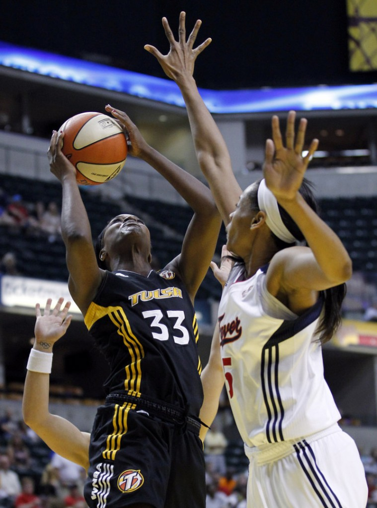 Tiffany Jackson of the Tulsa Shock tries to shoot over Indiana's Tangela Smith during the Fever's 82-74 victory Tuesday night.