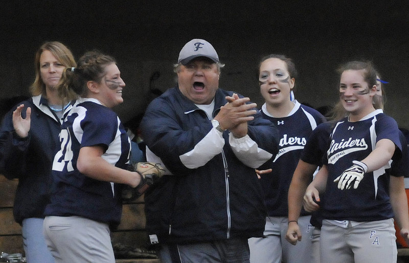 Fryeburg Academy Coach Fred Apt celebrates with his team Tuesday night after getting through an inning in the 6-1 victory against Oak Hill. The Raiders won the Western Class B title for the fourth consecutive season and will play at 11 a.m. Saturday for the state championship.