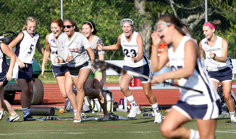 Yarmouth players charge onto the field to celebrate after beating North Yarmouth Academy 6-5 on Wednesday to win the Eastern Class B girls lacrosse championship.