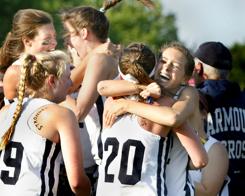 Becca Bell, left, and Kate Dilworth share a hug after Yarmouth earned a spot in the state championship game against Waynflete.