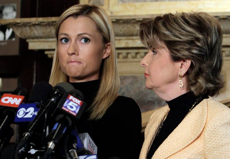 Former porn actress Ginger Lee, left, and attorney Gloria Allred attend a news conference Wednesday in New York. Lee said she and Rep. Weiner exchanged about 100 emails.
