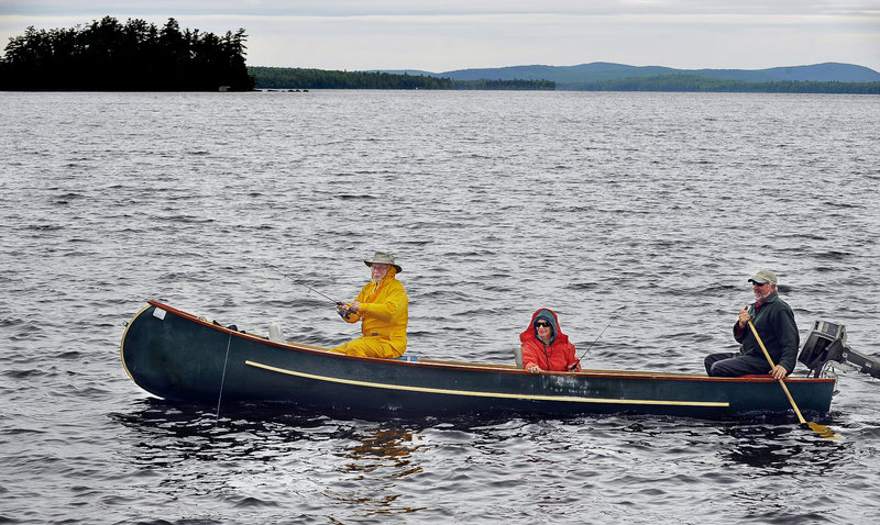 New Yorkers Arthur and Tobi Barr, annual visitors to the lake-filled region, fish Sysladobsis Lake with guide Dale Tobey, right, paddling his Grand Laker canoe.