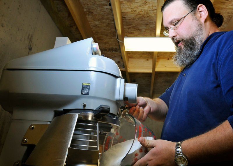 Doug Sanborn mixes his all-natural detergent in the basement of his home in Casco.