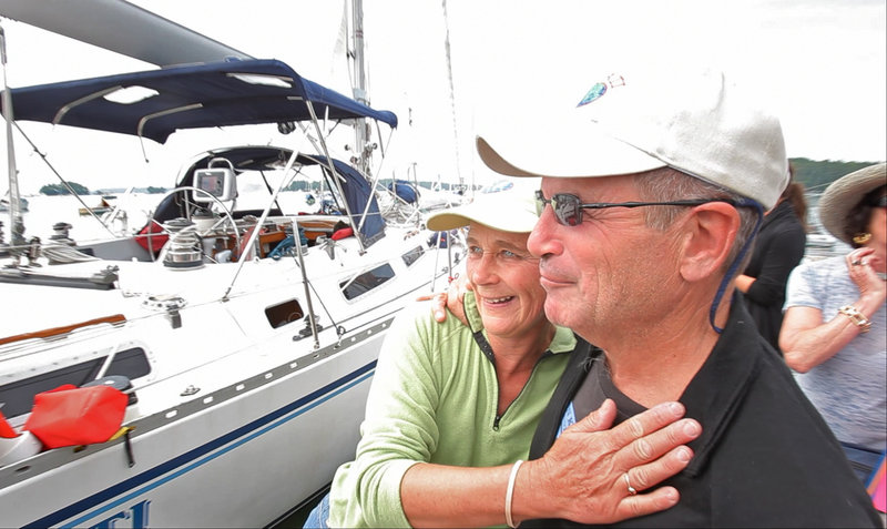 Nat and Betsy Warren-White celebrate after returning to Freeport. The round-the-world sailing trip was a lifelong dream of Nat's.