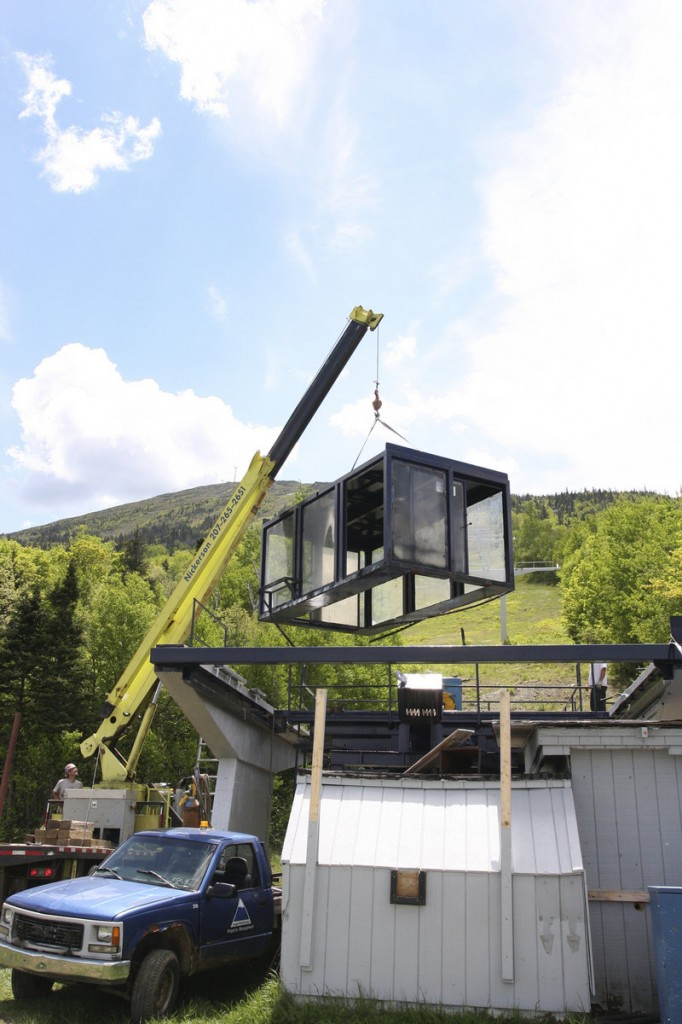 Workers dismantle the Spillway base station at Sugarloaf this month. The Spillway East chairlift, which derailed Dec. 28, will be replaced with a larger lift. Maine's chief tramway inspector did not recommend any enforcement action or changes in the state's oversight process.