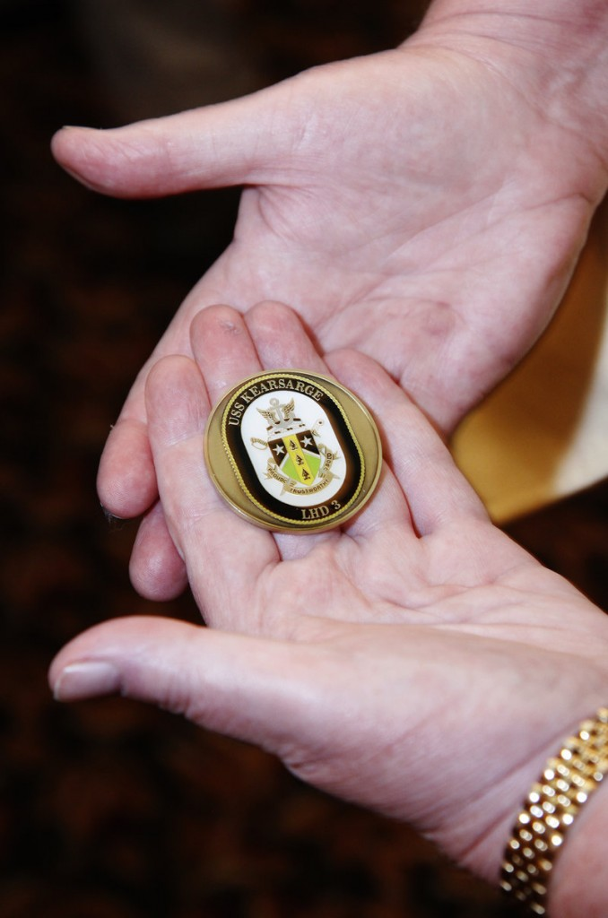 The ship's coin presented to Sen. Collins came from the USS Kearsarge, which Barnes served on during her time spent in the Navy.