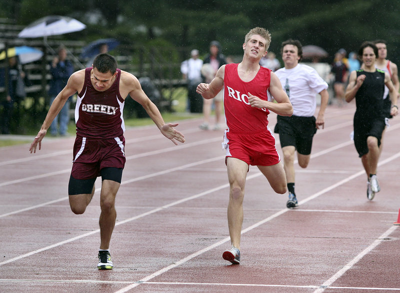 Nestor Taylor of Greely, left, and Matt Clement of South Portland cross the finish after the boys' 800 meter run. Taylor placed second and Clement third.