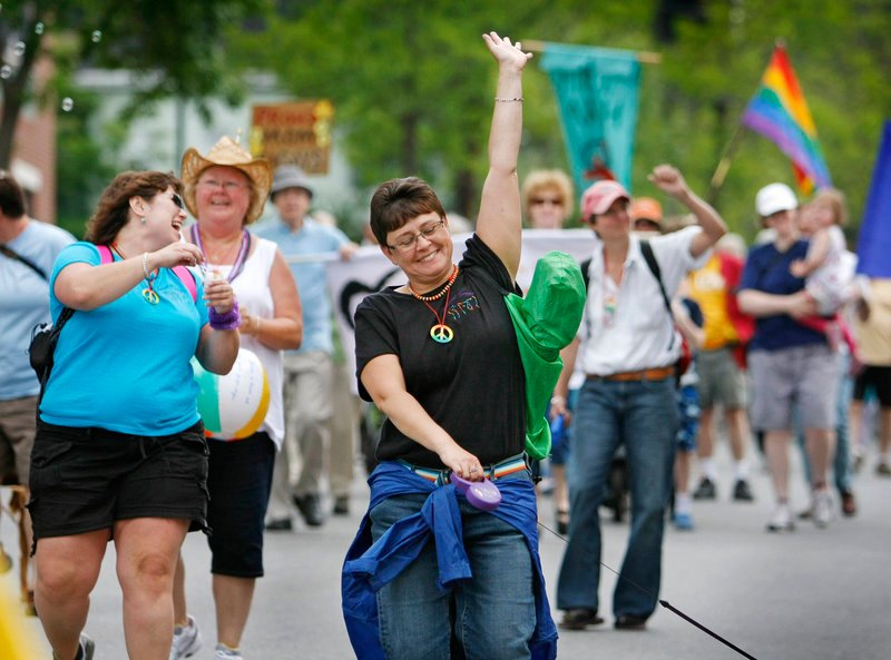 Jubilant participants march down High Street on the way to Deering Oaks Saturday during the 25th annual Southern Maine Pride Parade through Portland. The crowd of about 5,000 was a far cry from the 200 who gathered for the first pride festivities in 1986.
