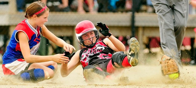Abby Rutt of Scarborough is safe at second after her slide ripped the ball and glove from second baseman Alei Collier of Messalonskee during the Class A state final at Augusta.