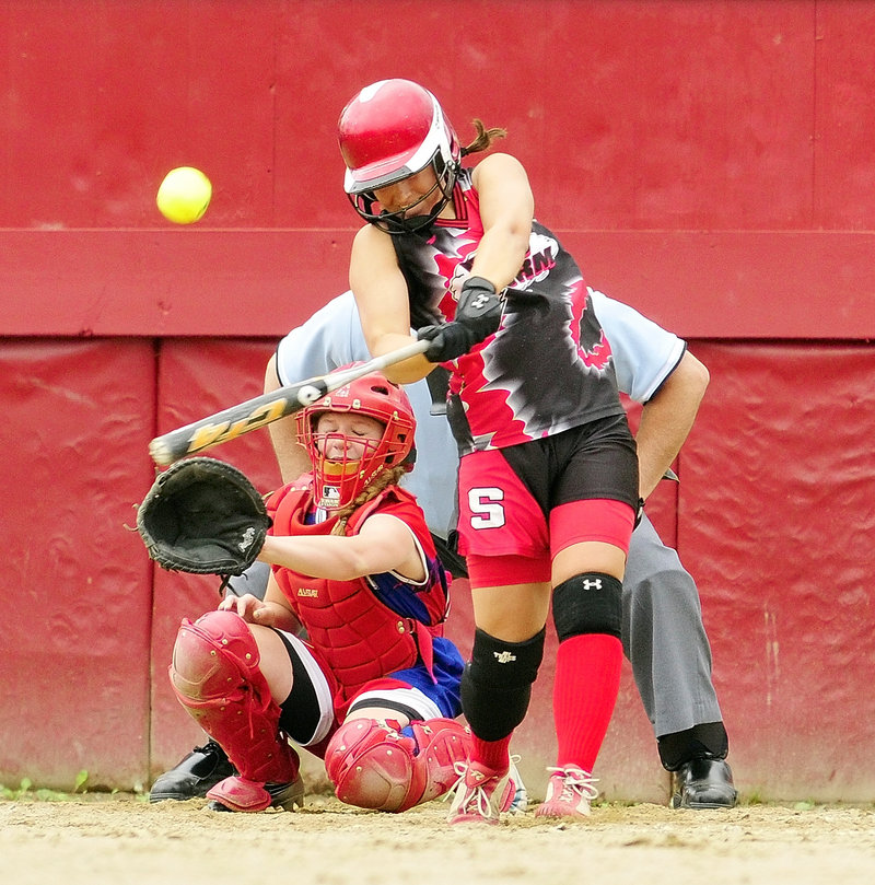 Erin Giles of Scarborough rips a run-scoring double in the fifth inning, driving in the third run of the inning on the way to a 5-0 victory against Messalonskee in the Class A softball final.