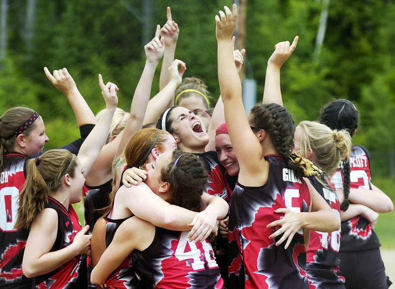 The Red Storm erupts in celebration Saturday after Scarborough made the last out against the Messalonskee Eagles in the Class A state championship softball game at Cony Family Field in Augusta. Scarborough blanked the Eagles 5-0.