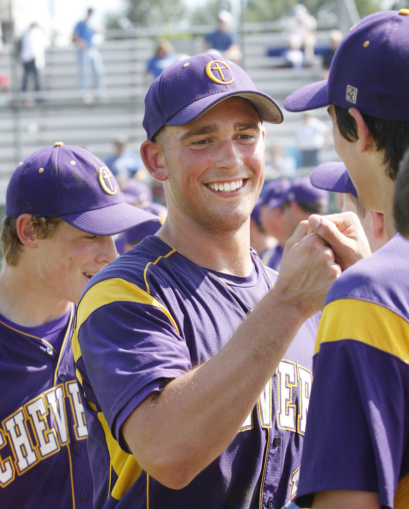 Joey Royer gets cheers from his teammates after pitching a complete game in Cheverus' Class A baseball state championship victory, 9-1, over Lewiston at Morton Field in Augusta on Saturday.