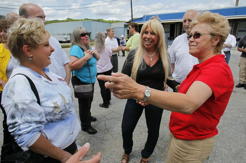 Patriarch Partners CEO Lynn Tilton, center, meets with millworker families June 10 at Gorham Paper and Tissue in Gorham, the last paper mill in New Hampshire's North Country.