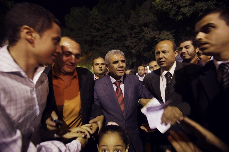 Sobhi Saleh, center, a senior member of the Muslim Brotherhood and former member of parliament, is surrounded by supporters in May in Cairo, Egypt.