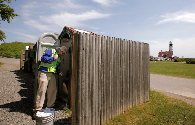 Ray Routhier sweeps out a porta potty at Fort Williams Park in Cape Elizabeth while he learns the duties of a park ranger.