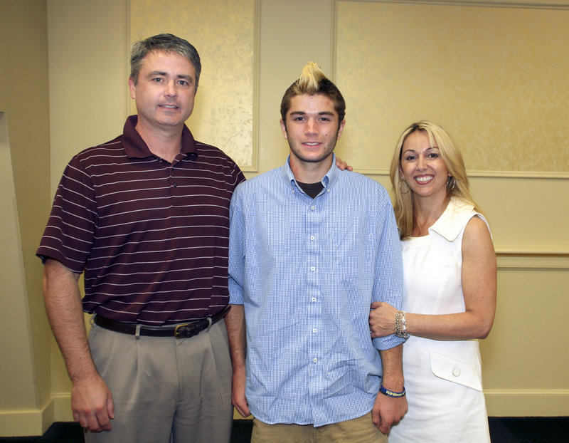 Mitch Tapley, the boys' lacrosse MVP from Falmouth, poses with his parents, Joe and Christina.