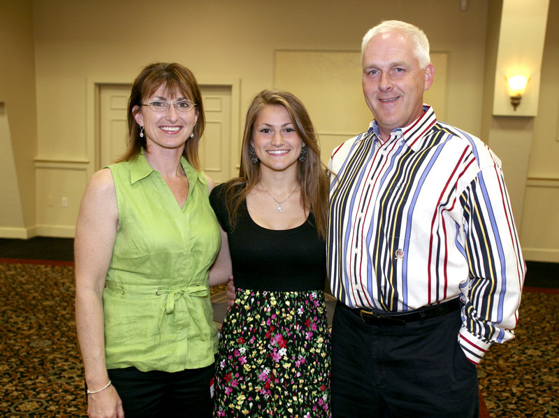 Nicole Kirk, the girls' indoor track MVP from Scarborough, with her parents, Carolyn and Jeff.