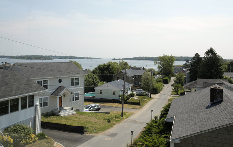 The view of Casco Bay and the Willard Beach area from an upstairs bedroom at Sharan Townsend's home. When planning its redesign, Sokol took into consideration what might happen if other neighborhood homeowners built up.