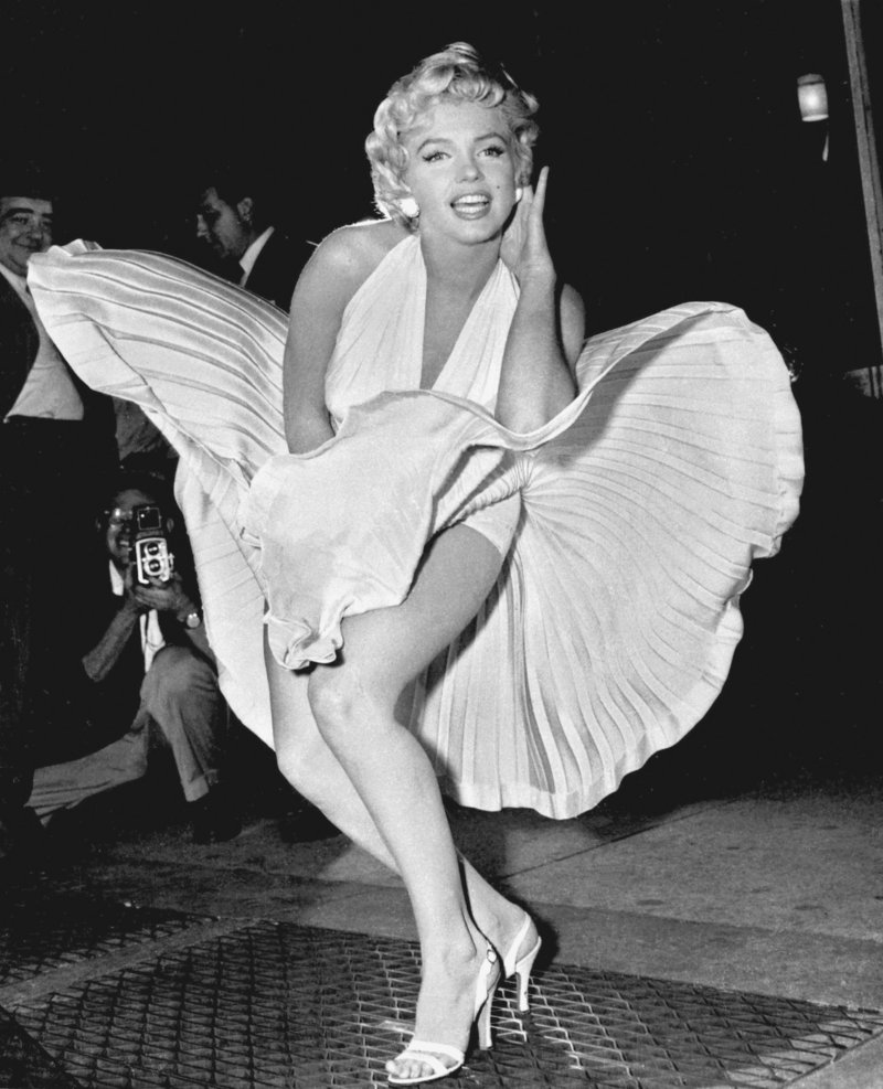 """Marilyn Monroe poses over the updraft of a New York subway grating while in character for the filming of """"The Seven Year Itch"""" in this Sept. 9, 1954, photo. The dress was auctioned off Saturday."""