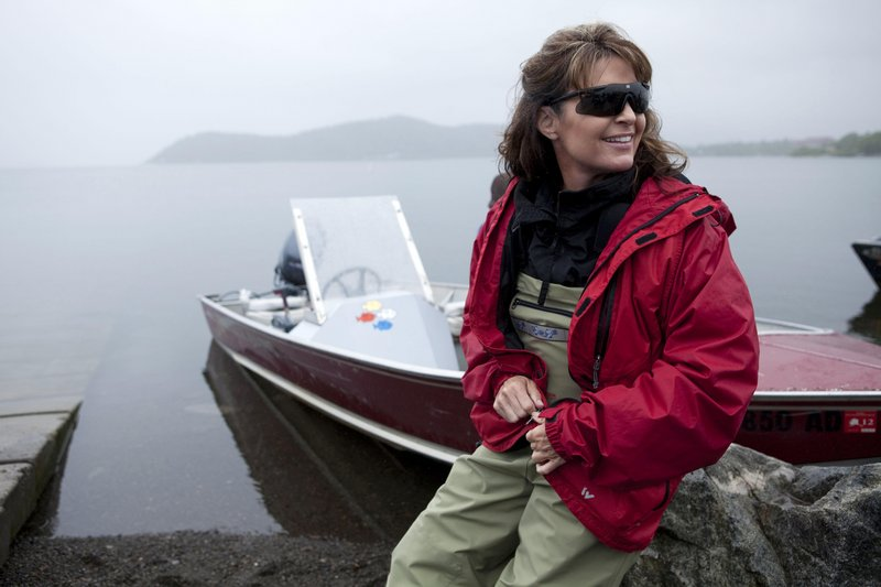 """Sarah Palin poses next to her husband Todd's boat in Dillingham, Alaska, in July 2010 as part of a documentary series for TLC. """"Sarah Palin's Alaska"""" attracted an average of 3 million viewers per episode. Filmmaker Stephen K. Bannon is hoping for a similar response to """"The Undefeated."""""""