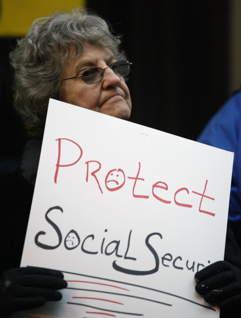 An opponent of changes to Social Security demonstrates at a National Council on Aging meeting in Philadelphia in 2005.