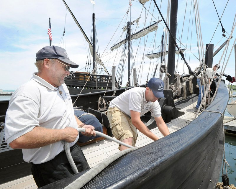 First mate Vic Bickel and crew member Alex Roberts secure the Nina to the dock at South Port Marine in South Portland, where the vessels – which travel the Americas as floating museums – will stay through Monday.