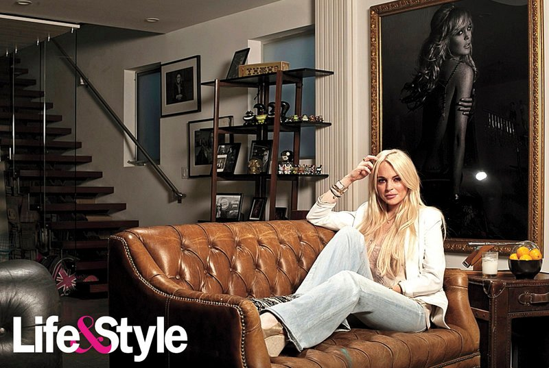 Lindsay Lohan poses on a couch in her Venice Beach, Calif., home for a publicity photo taken for Life & Style magazine. While house arrest isn't ideal, she says she treasures moments alone at home.