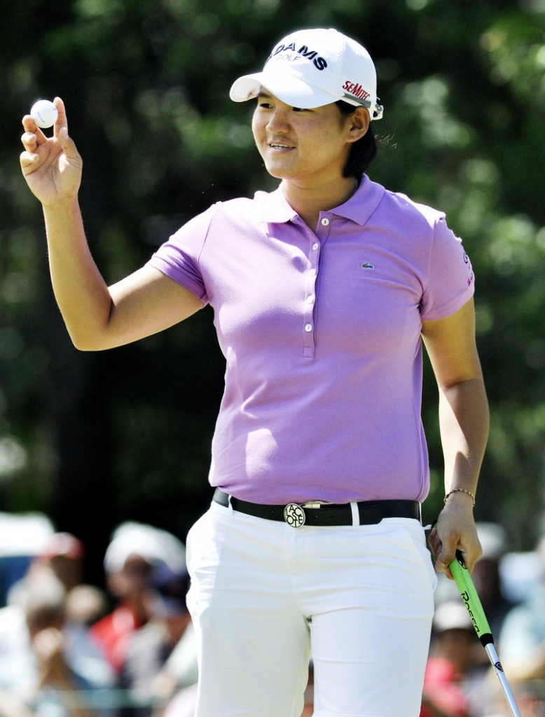 Yani Tseng reacts to the gallery at the ninth hole after sinking a birdie putt Thursday on the way to a 6-under 66, good for the first-round lead in the LPGA Championship.