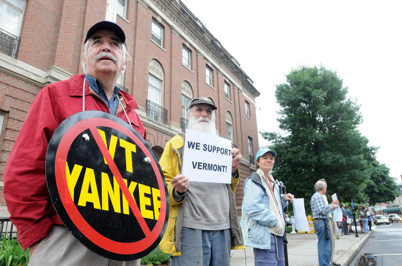 Demonstrators held a vigil outside the federal courthouse in Brattleboro, Vt., Thursday while Vermont Yankee owners asked a federal judge for an order to keep the plant running.