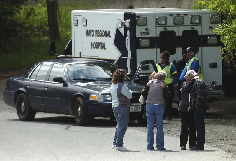 Relatives gather near the home of Steven and Amy Lake on June 13. Readers say such situations need to be addressed far earlier.