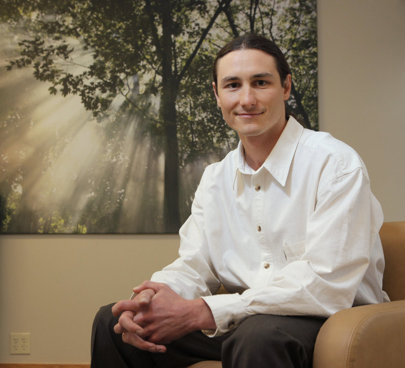 Dr. Dustin Sulak, shown in his Falmouth office, typically recommends treatments beyond cannabis, including vitamin D, turmeric or milk thistle supplements.