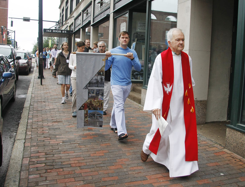 The Rev. Robert Witham leads the Williston-West congregation down High Street in Portland, on its way to a special service to merge with Immanuel Baptist Church as the new Williston-Immanuel United Church.