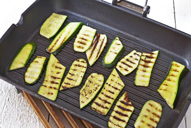 Moisture-heavy vegetables like zucchini can stick to a grill that isn't hot enough, but a too-hot fire can quickly turn your veggies into charcoal if you're not careful.