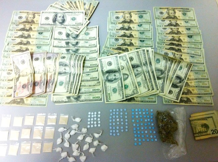 Drugs and money confiscated in South Portland bust.