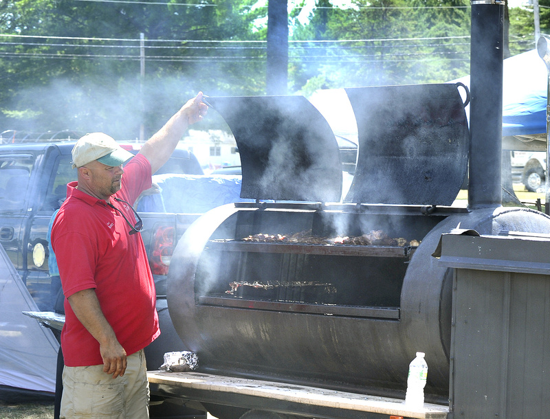 Scott Carter from Steep Falls checks on his entries today during the Western Maine BBQ Festival in Fryeburg.