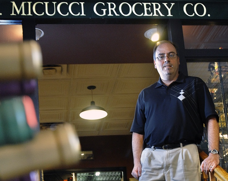Rick Micucci, owner of Micucci Grocery on India Street in Portland, remembers times when his father would buy an entire rail car full of canned tomatoes.