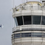 A passenger jet flies past the FAA control tower at Washington's Ronald Reagan National Airport. FAA officials say they will not allow air traffic controllers to take catnaps during breaks, the surest remedy to drowsiness on the job.