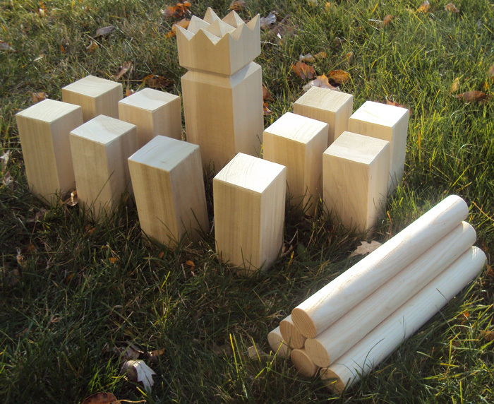 A kubb set includes the king, wooden blocks and throwing sticks. The game, a favorite in Sweden, is gaining fans on this side of the Atlantic. It involves throwing a stick to knock over an opponent's blocks and then the king.