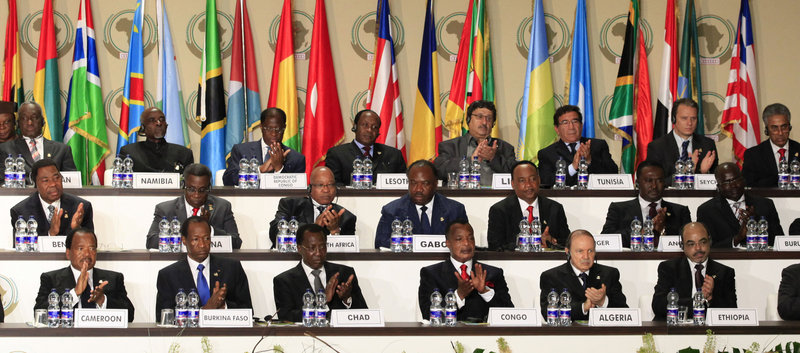Leaders applaud during the opening session of the 17th African Union Summit outside Malabo, Equatorial Guinea, on Thursday. The AU was divided between those wanting to issue a call for Gadhafi's departure and those arguing that he is an elected head of state and cannot be forced out.