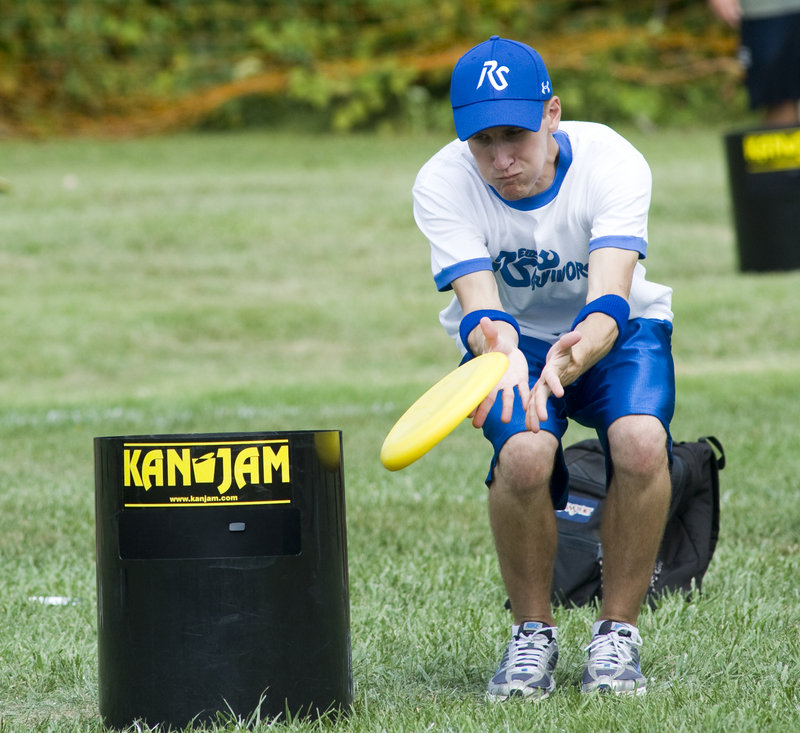 A KanJam player can deflect the disc to help it hit or land in the can. The disc can enter the can at the top or through a slot in its side.
