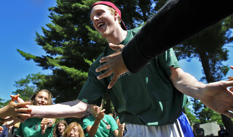 Kyle Singler, who helped Duke win the national championship in 2010 and last month became a second-round draft choice of the Detroit Pistons, is greeted by the Seeds of Peace campers Thursday. NBA players were on hand to teach basketball and interact with campers.