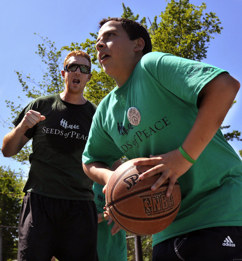 Brian Scalabrine of the Chicago Bulls, and a member of the Boston Celtics' 2008 title team, urges on Jabra, a Seeds of Peace camper from Palestine. Only first names are used for campers because of security concerns in the Middle East.