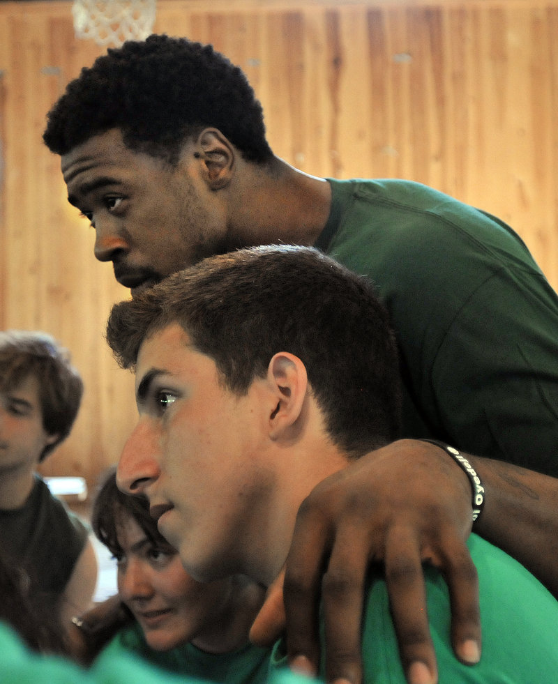 DeAndre Jordan of the Los Angeles Clippers puts his arm around Almog, a camper from Nahariya, Israel, which is less than 10 miles from the border with Lebanon. The city was targeted for rocket attacks six years ago.