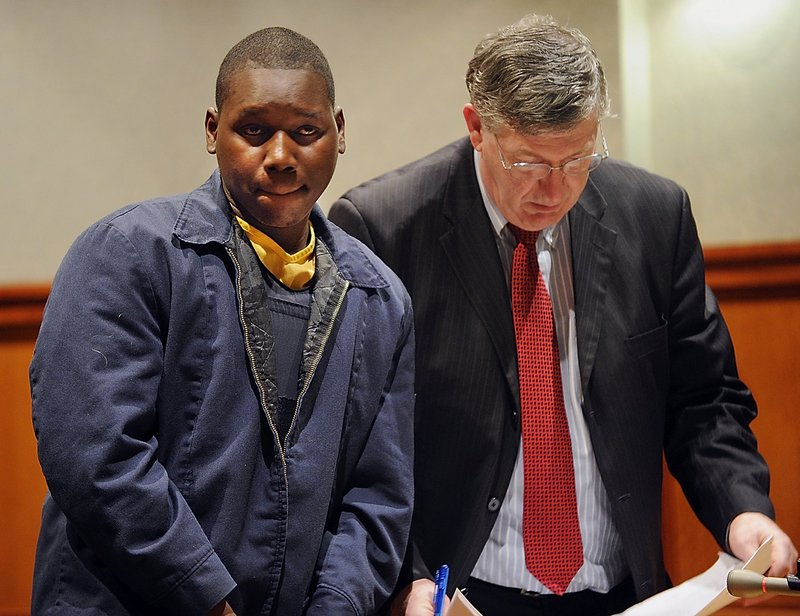 Moses Okot appears at his February 2010 arraignment in Cumberland County Superior Court in Portland.